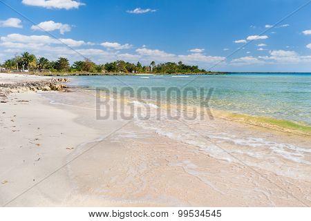 Soft Wave Of The Sea On The Sandy Beach. Blue Sky, White Sand, Palm Trees And Azure Sea. Cuba.