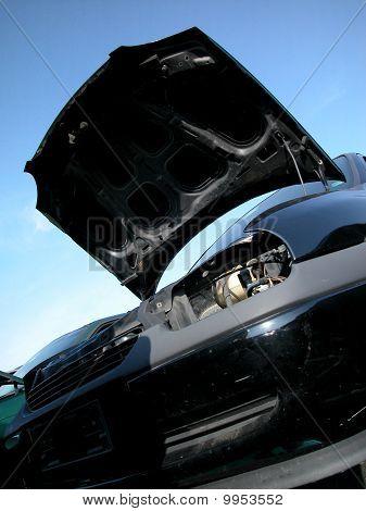 Old Black Car At Junkyard