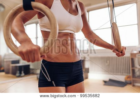 Woman's Hands Holding Gymnastic Rings