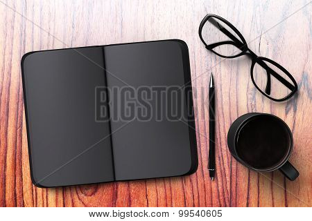 Black Blank Diary With Cup Of Coffee And Glasses