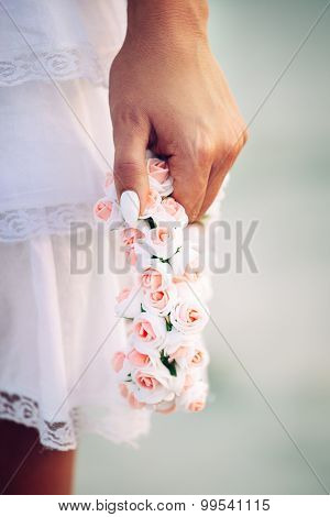 Holding flowers on a girl's hands