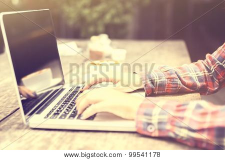 Woman Typing On A Laptop At Sunrise