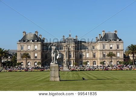 PARIS FRANCE - SEPTEMBER 12 2014: People enjoy sunny day in the Luxembourg Garden in Paris. Luxembourg Palace is the official residence of the French Senate.