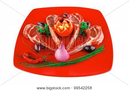 ribs served on red plate with tomatoes and greenery