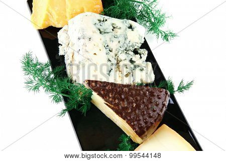 french aged cheeses on black ceramic plate