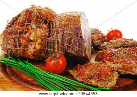 served peppered roast meat chops on wood