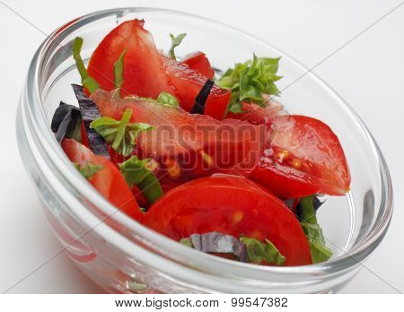 Tomato Salad With Green And Red Basil In A Glass Bowl