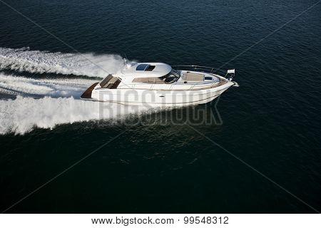 A Fast Motor Boat Sailing Through The Sea