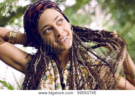 young adorable pretty girl with pigtails hairstyle smiling outside