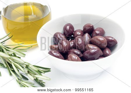 Kalamata Black Olives In A White Bowl And Olive Oil, Rosemary Garnish