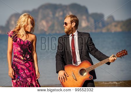 Blonde And Guitarist Side-view Against Island