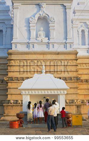 People pray at the Ruwanwelisaya stupa in Anuradhapura, Sri Lanka.