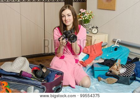 Girl Holding A Camera Going On Vacation