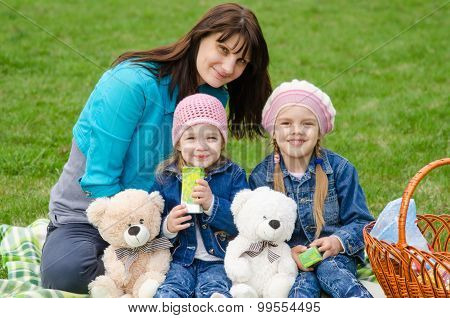 Mum Embraces Daughters On A Picnic