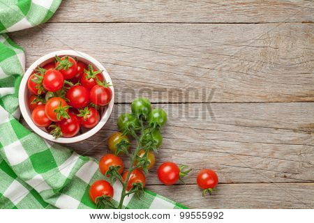 Cherry tomatoes on wooden table. Top view with copy space