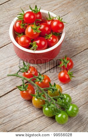 Cherry tomatoes on wooden table. Top view