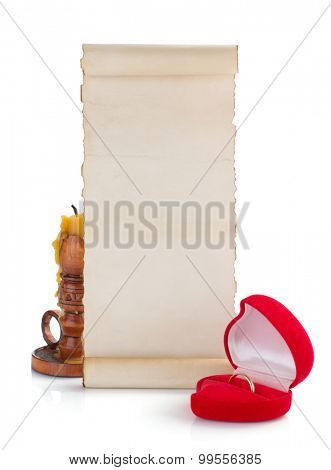 wedding ring and aged paper on white background
