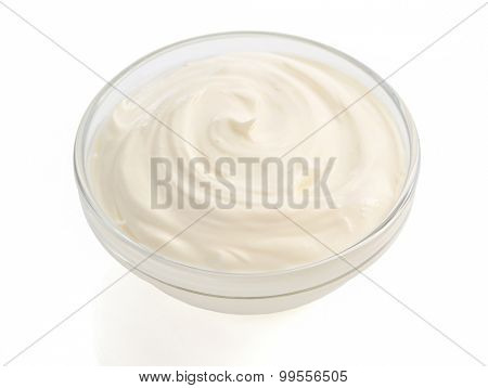 sour cream in bowl on white background