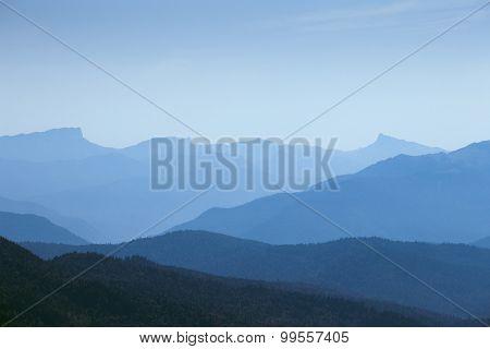 silhouette mountain under blue sky