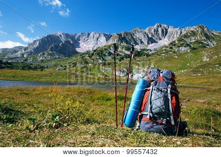 backpack with nordic walking sticks in mountain