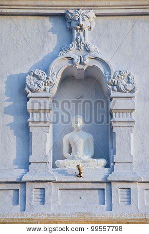 Exterior of the Buddha statue at Ruwanwelisaya stupa in Anuradhapura, Sri Lanka.