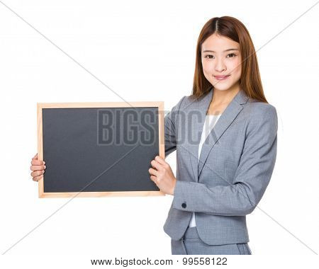 Asian young businesswoman show with empty blackboard