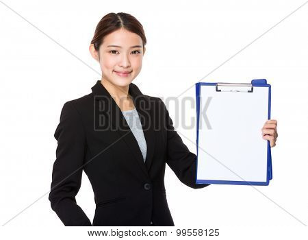 Asian Young businesswoman show with the blank page of clipboard