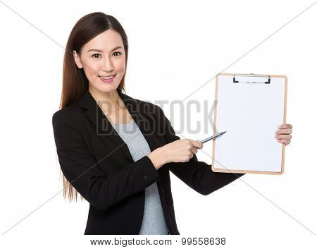 Asian young businesswoman with pen point to clipboard