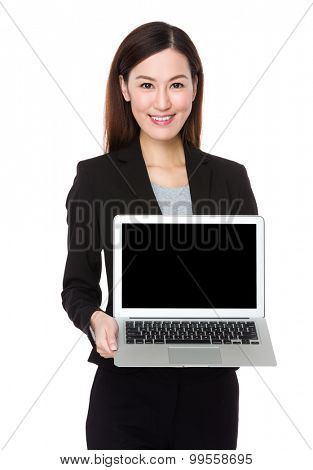 Businesswoman show with the blank screen of notebook computer