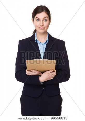 Brunette young businesswoman hold with clipboard