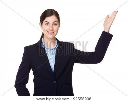 Brunette young businesswoman with open hand palm