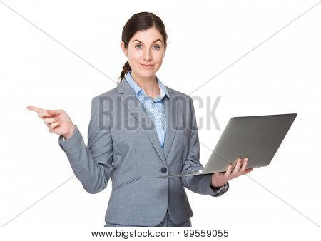 Businesswoman use of the notebook computer and finger point aside