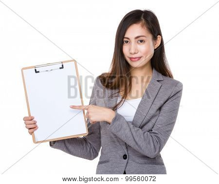 Asian young businesswoman with finger point to clipboard