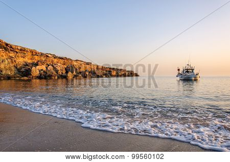 Fishing boat lies at sundown
