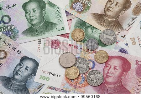 A Collage Of Chinese Rmb Bank Notes And Coins