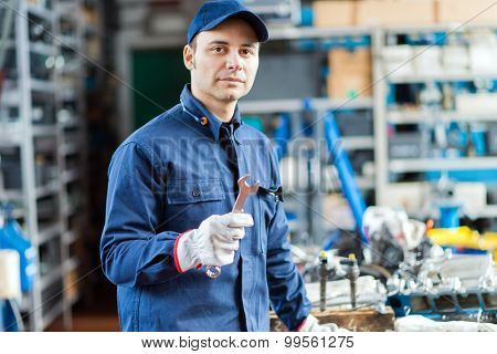 Auto mechanic in his workshop