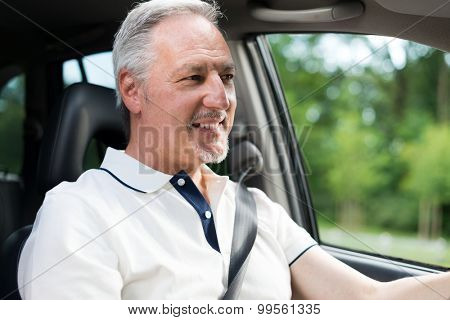 Smiling man driving his car