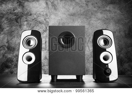 Modern black sound speakers on dark background