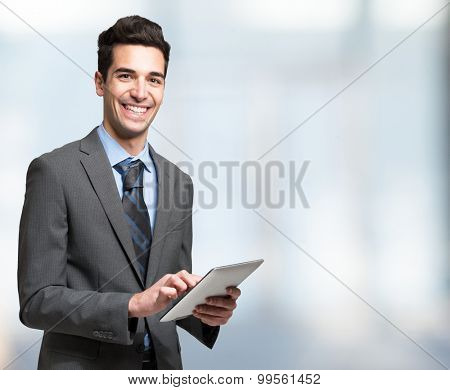 Portrait of a smiling man using a tablet computer