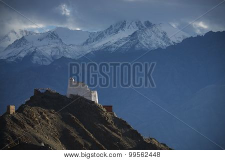 Namgyal Tsemo Gompa from behind and snow mountain range background Leh, Ladakh, India.