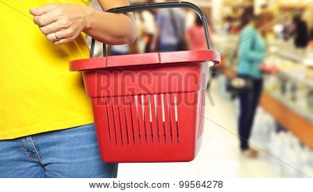 Women holding empty shopping basket - Shopping concept
