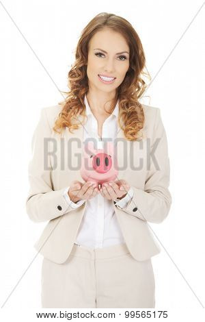 Happy business woman with a piggybank.