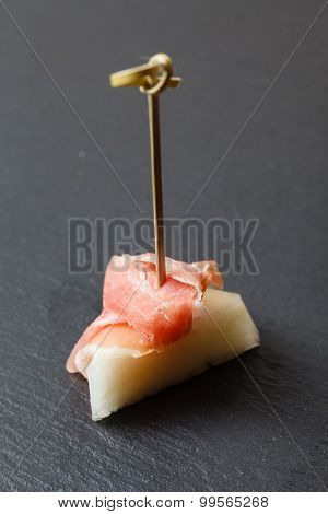 Appetizer with melon and prosciutto