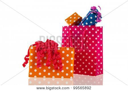 Colorful bag with birthday gifts isolated over white background
