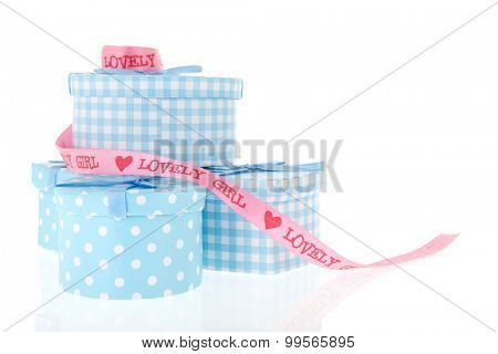 Gifts for the newborn baby girl in blue isolated over white background