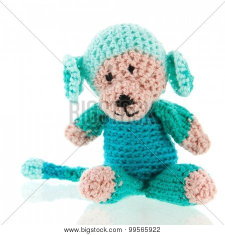 Knitted stuffed monkey isolated over white background
