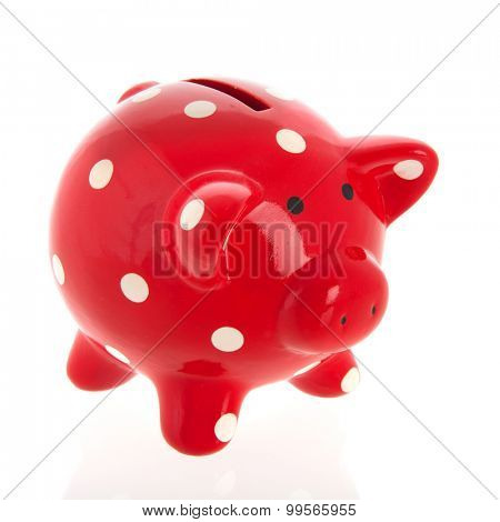 Red spotted piggy bank isolated over white background