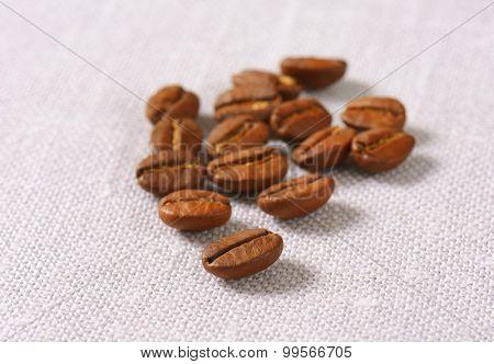 Roasted coffee beans on linen napkin