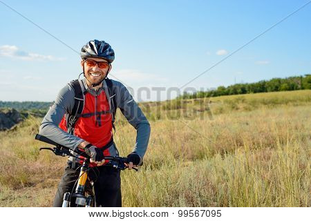 Portrait of Young Cyclist in Helmet and Glasses. Sport Lifestyle Concept.
