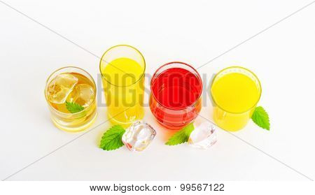 fresh fruit juices and iced drinks on white background